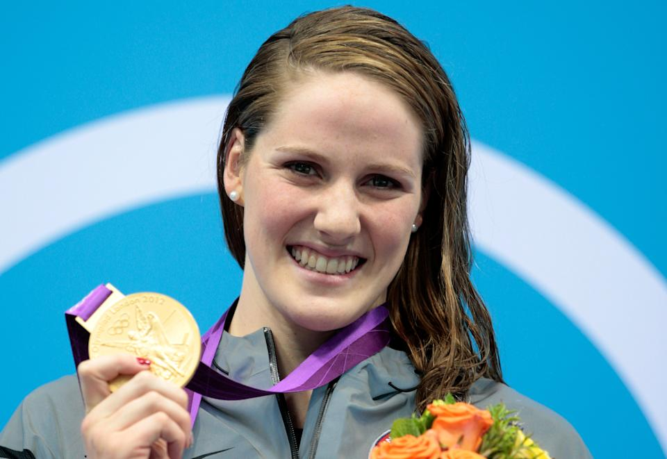 """<a href=""""http://sports.yahoo.com/olympics/swimming/missy-franklin-1132902/"""" data-ylk=""""slk:Missy Franklin"""" class=""""link rapid-noclick-resp"""">Missy Franklin</a> of the United States celebrates with her gold medal during the medal ceremony for the Women's 100m Backstroke on Day 3 of the London 2012 Olympic Games at the Aquatics Centre on July 30, 2012 in London, England. (Photo by Adam Pretty/Getty Images)"""