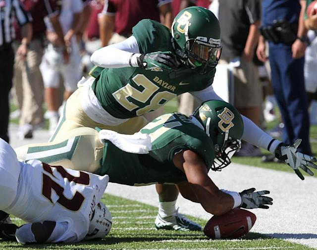 Baylor safety Patrick Levels (21) recovers a fumble by Louisiana-Monroe running back Cortney Davis (22) on a kick return in the first half of an NCAA college football game, Saturday, Sept. 21, 2013, in Waco, Texas. (AP Photo/Waco Tribune Herald, Jerry Larson)