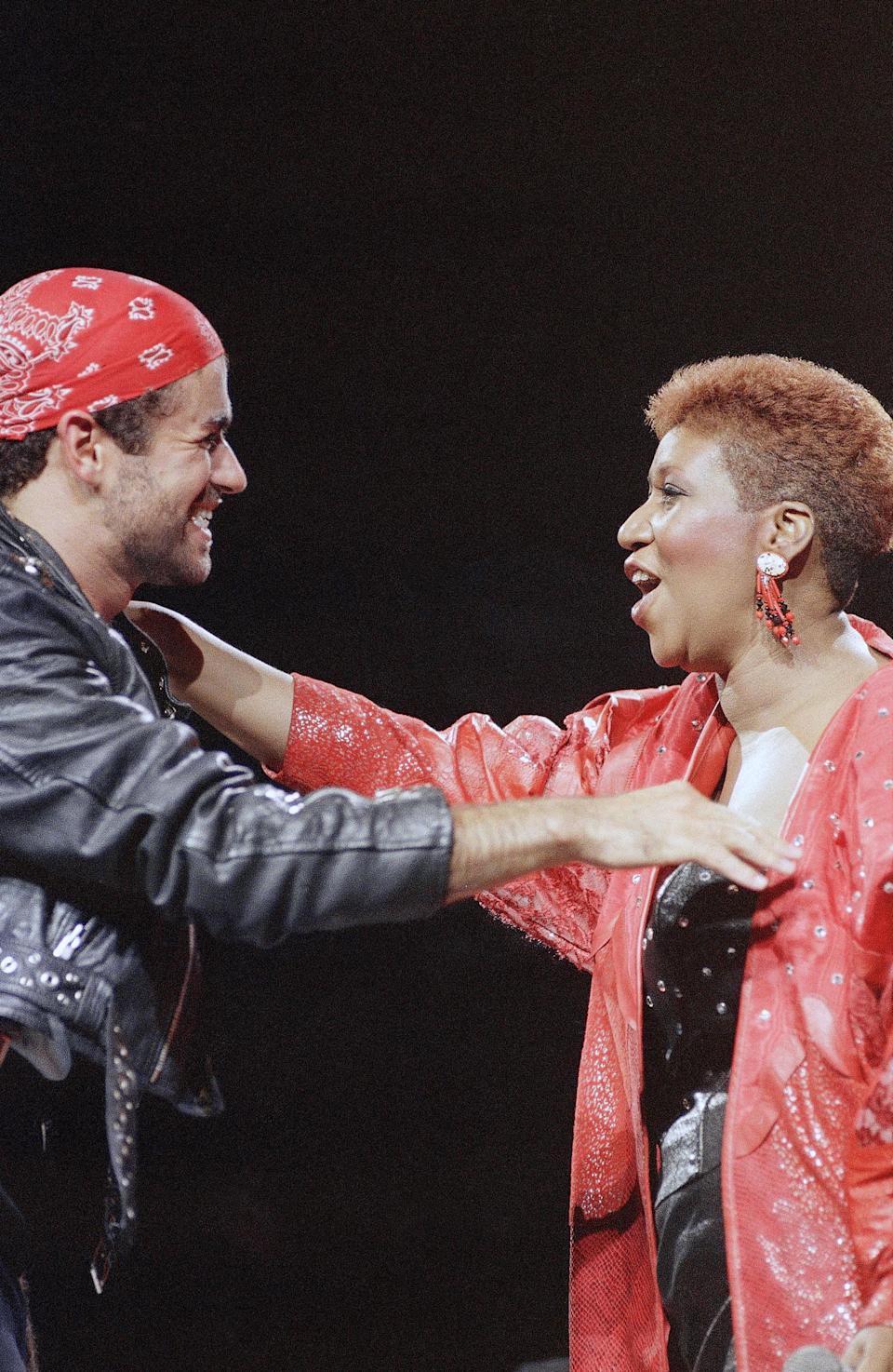 """<p>Aretha Franklin, wearing a red leather studded jacket and short auburn haircut, joins George Michael on stage during his Faith World Tour in Detroit. The duo sang their Grammy-winning hit """"I Knew You Were Waiting."""" (AP Photo/Rob Kozloff) </p>"""