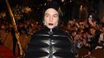 The 26-year-old actor made a dramatic fashion statement in a full head-to-toe black puffer ensemble and vampy dark lips.