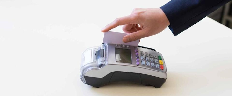 Close Up hand of the man using EDC machine for a credit card at the catcher.