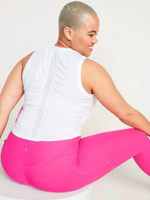 <p>The back ruching on this <span>Old Navy UltraLite Mesh-Stripe Performance Tank Top</span> ($8, originally $20) sets all three colors apart from a standard tank, but it's hard to go wrong with classic white.</p>