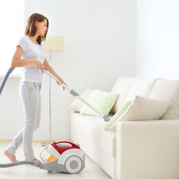 """<p>""""Pull furniture away from walls and vacuum behind and under it,"""" Forte says. """"Do the woodwork and air vents while you're back there."""" Then switch the upholstery tool on your machine to go over both sides of cushions and underneath them. The crevice tool is a great way to remove any gunk along the trim and stitching. <br></p>"""