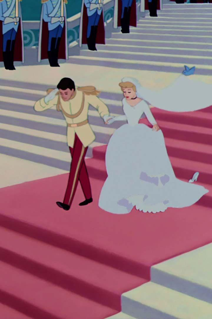 <p>After Prince Charming slides the glass slipper onto Cinderella's foot, she wore a long-sleeve scoop-neck wedding gown with a full skirt and trailing veil, held up by, yes, birds.</p>