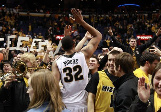Missouri's Steve Moore celebrates with fans after Missouri's 78-74 victory over Illinois in an NCAA college basketball game Thursday, Dec. 22, 2011, in St. Louis. (AP Photo/Jeff Roberson)