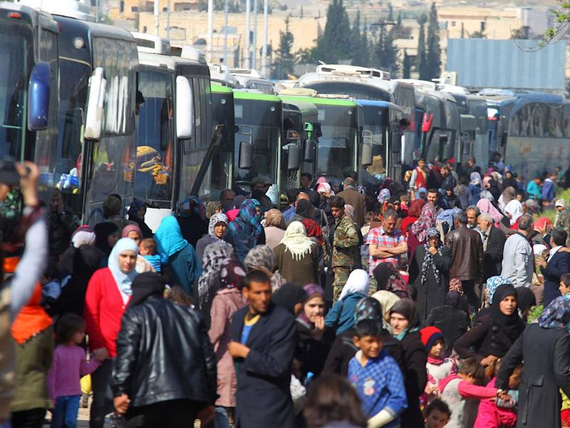 People evacuated from the two villages of Kefraya and Foua were left stranded in al-Rashideen, Aleppo province, on 15 April (Reuters)
