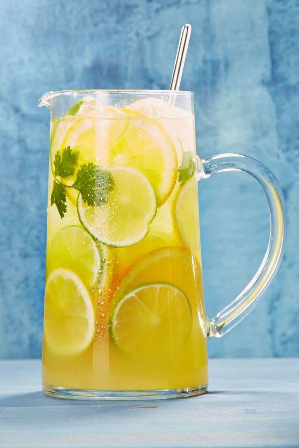 """<p>Make your Super Bowl a bonafide Sunday Funday with this margarita-sangria hybrid that includes tequila, triple sec, and white wine. </p><p><a href=""""https://www.goodhousekeeping.com/food-recipes/a44204/citrusy-white-sangria-margarita-recipe/"""" rel=""""nofollow noopener"""" target=""""_blank"""" data-ylk=""""slk:Get the recipe for Citrusy White Sangria Margarita »"""" class=""""link rapid-noclick-resp""""><em>Get the recipe for Citrusy White Sangria Margarita »</em></a></p>"""