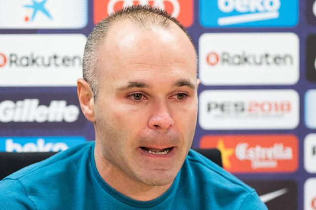 Andres Iniesta was in tears at a news conference during which he confirmed he would be leaving FC Barcelona at season's end. (Getty)