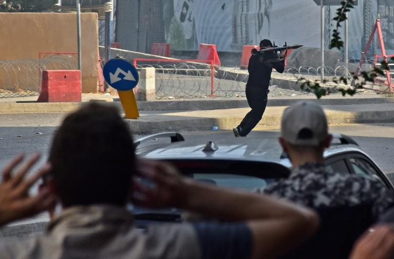 A Shiite activist armed with a rocket-propelled grenade launcher moves along a street in the Tayouneh area of Beirut (AFP/-)