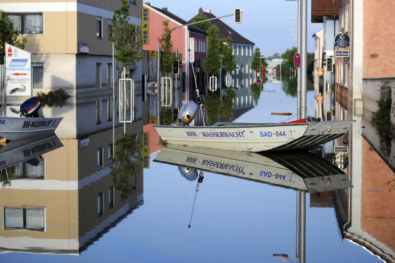 Buildings and boats are reflected in the floodwater of the river Danube in Deggendorf, southern Germany, Friday, June 7, 2013. Heavy rainfalls in the past days caused flooding along rivers and lakes in Germany, Austria, Switzerland, Hungary and the Czech Republic. (AP Photo/dpa, Marius Becker)