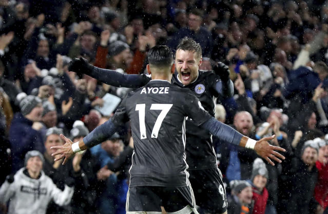 Leicester City's Ayoze Perez celebrates scoring his side's first goal of the game with team mate Jamie Vardy, during the English Premier League soccer match between Brighton and Hove and Leicester City, at the AMEX Stadium, in Brighton, England, Saturday, Nov. 23, 2019. (Gareth Fuller/PA via AP)