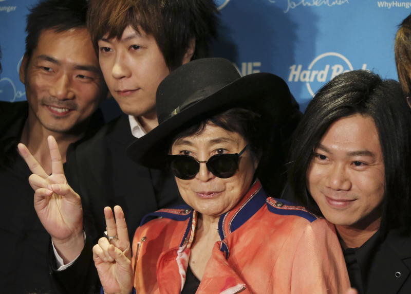 "Yoko Ono poses for photos with members of Taiwanese rock band ""Mayday""during a campaign to fight childhood hunger around the world, in Tokyo Thursday, Dec. 5, 2013. The 80-year-old widow of John Lennon said that she believes he would be happy to see his song ""Imagine"" used by WhyHunger and Hard Rock to raise support for their child nutrition and sustainable farming efforts in 22 countries. Mayday members are, from left, Stone, Ashin and Masa. (AP Photo/Koji Sasahara)"