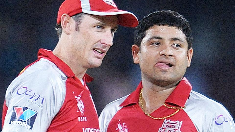 David Hussey, pictured here talking with Piyush Chawla during an IPL game in 2012.