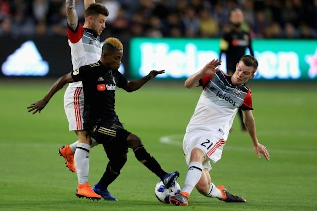DC United midfielder Chris Durkin, at right against Los Angeles FC's Latif Blessing, was transfered to Belgium's Sint-Truidense on Thursday (AFP Photo/Sean M. Haffey)
