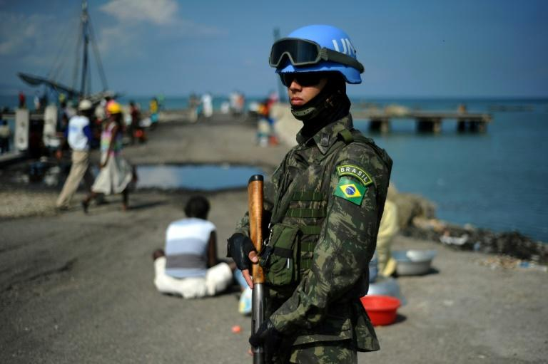 A Brazilian member of the UN peackeeping mission in Haiti patrols the Cite Soleil slum of the capital Port-au-Prince in this file photo