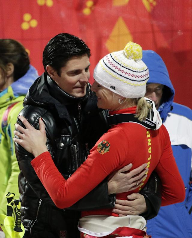 Germany's Maria Hoefl-Riesch is greeted by her husband, Marcus Hoefl after completing the second run of the women's slalom at the Sochi 2014 Winter Olympics, Friday, Feb. 21, 2014, in Krasnaya Polyana, Russia. (AP Photo/Gero Breloer)