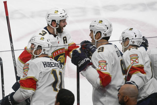 Florida Panthers defenseman Keith Yandle (3) celebrates with Florida Panthers left wing Jonathan Huberdeau(11), Florida Panthers center Brian Boyle (9) and Florida Panthers defenseman Mark Pysyk after Yandle scored against the Minnesota Wildduring the first period of an NHL hockey game Monday, Jan. 20, 2020, in St. Paul, Minn. (AP Photo/Craig Lassig)