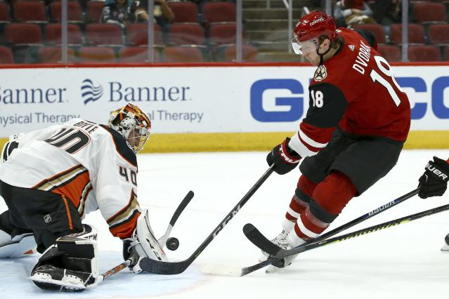 Arizona Coyotes center Christian Dvorak (18) has his shot blocked by Anaheim Ducks goaltender Kevin Boyle (40) during overtime in a preseason NHL hockey game Saturday, Sept. 21, 2019, in Glendale, Ariz. The Coyotes won 4-3 in a shootout. (AP Photo/Ross D. Franklin)