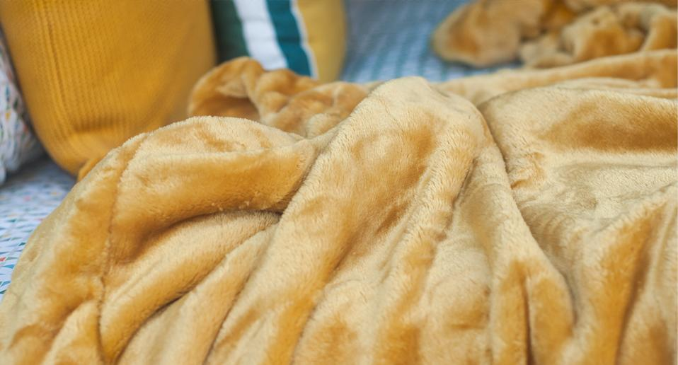 Searching for a new cosy bed throw? We've found a top-rated one that's worth every penny. (product not pictured, Getty Images)