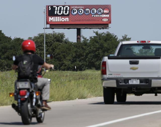 <p>A billboard advertising the Powerball jackpot stands in Bellevue, Neb., Aug. 23, 2017. Lottery officials said the grand prize for Wednesday night's drawing has reached $700 million. The second -largest on record for any U.S. lottery game. (Photo: Nati Harnik/AP) </p>
