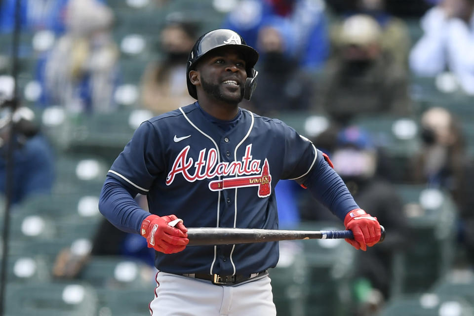 Atlanta Braves' Guillermo Heredia reacts after striking out during the second inning of a baseball game against the Chicago Cubs Saturday, April 17, 2021, in Chicago. (AP Photo/Paul Beaty)