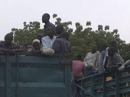 Former Nigerian hostages held by Boko Haram who were freed by the Cameroonian military arrive in Maroua, Cameroon, in this still image taken from a December 5, 2015 video footage.  REUTERS/Reuters TV
