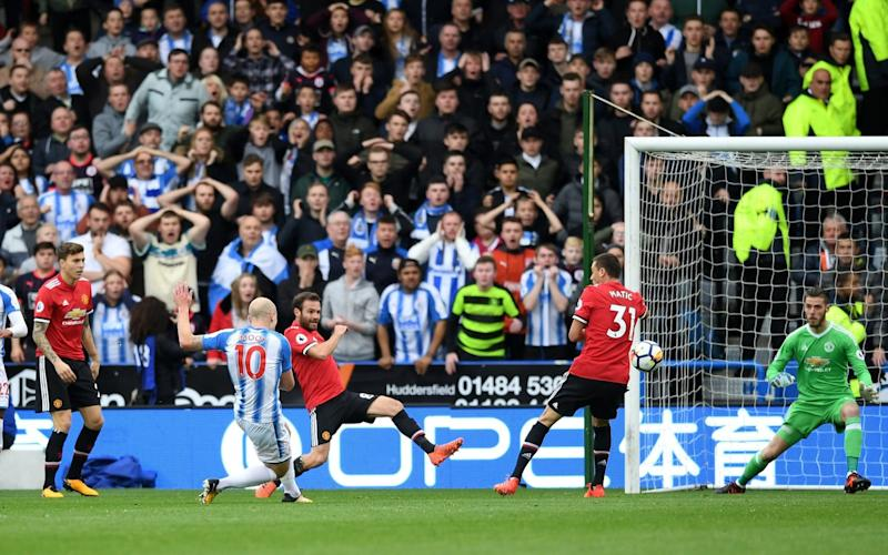 Aaron Mooy took advantage of Juan Mata's error to open the scoring for Huddersfield - Getty Images Europe