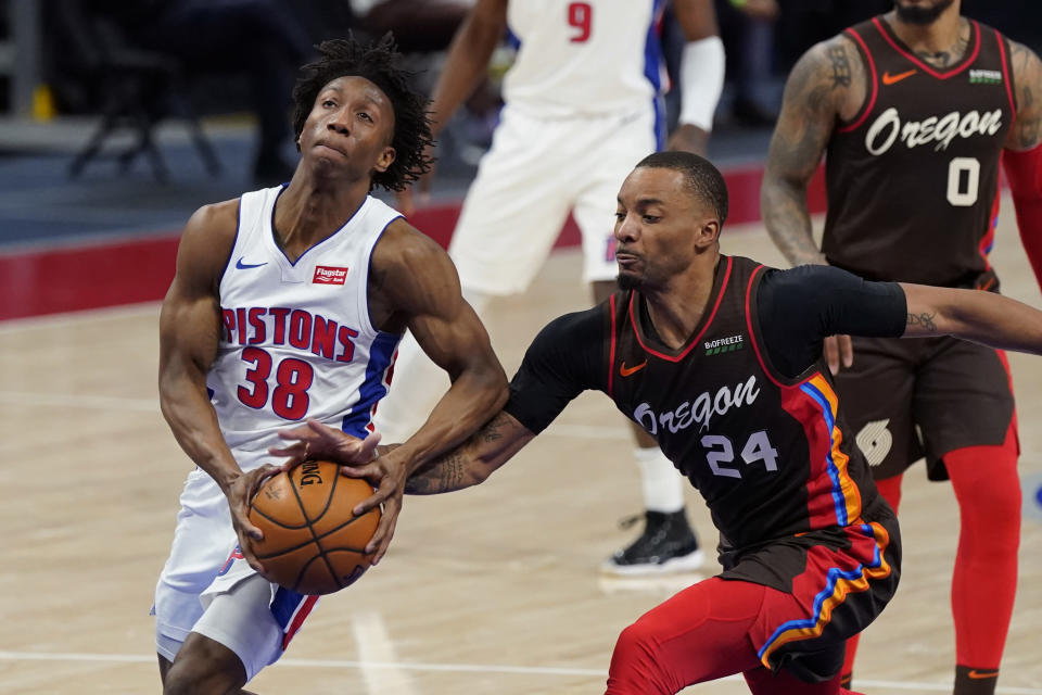 Portland Trail Blazers forward Norman Powell (24) knocks the ball away from Detroit Pistons guard Saben Lee (38) during the second half of an NBA basketball game, Wednesday, March 31, 2021, in Detroit. (AP Photo/Carlos Osorio)