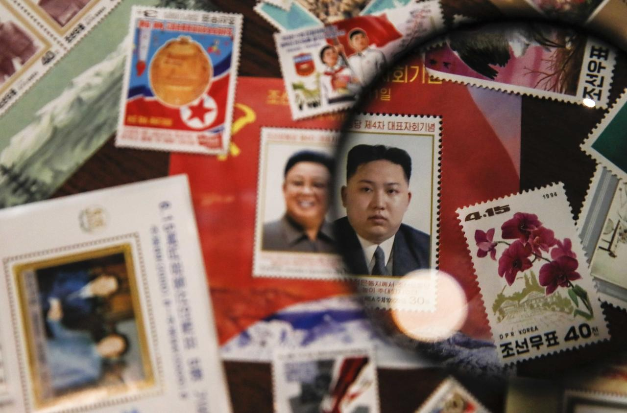 "Post stamps with images of North Korean leaders Kim Jong Un and Kim Jong-il are seen at the ""Made In North Korea"" exhibition held at the UMAM museum in Moscow, Russia January 20, 2018. REUTERS/Maxim Shemetov"