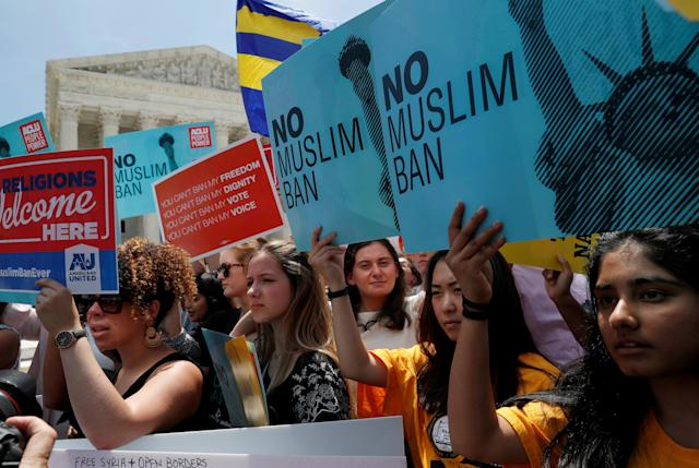 <p>People protest outside of the U.S. Supreme Court after the President Trump's travel ban was upheld by the U.S. Supreme Court in Washington, June 26, 2018. (Photo: Leah Millis/Reuters) </p>