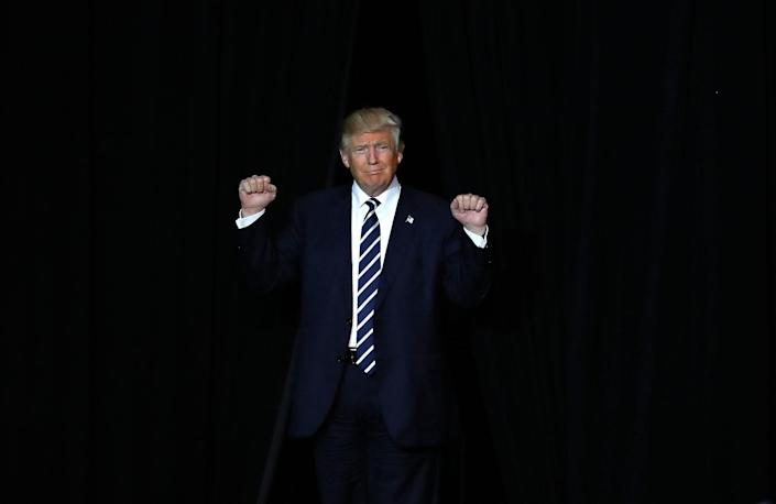 <p>Republican presidential candidate Donald Trump arrives at a campaign rally in Grand Rapids, Mich., Tuesday, Nov. 8, 2016. (Photo: Paul Sancya/AP) </p>