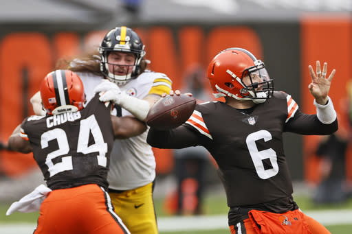 Cleveland Browns quarterback Baker Mayfield (6) throws during the first half of an NFL football game against the Pittsburgh Steelers, Sunday, Jan. 3, 2021, in Cleveland. (AP Photo/Ron Schwane)