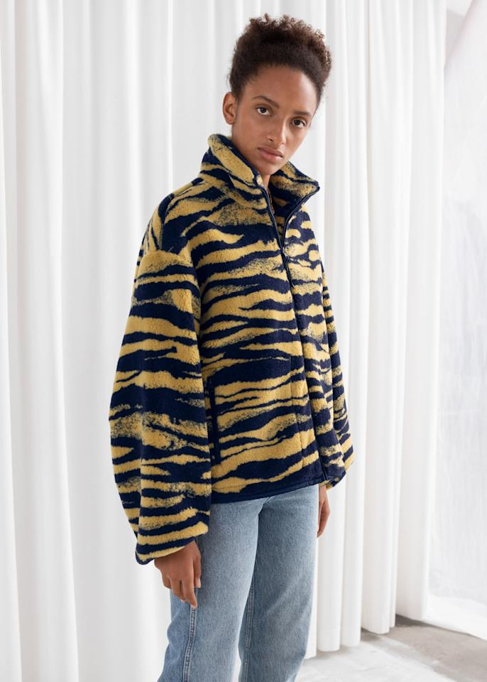 """$149, & Other Stories. <a href=""""https://www.stories.com/en_usd/clothing/jackets-and-coats/product.relaxed-utility-fleece-jacket-tiger-print.0764035003.html"""">Get it now!</a>"""