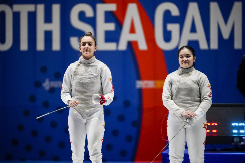 Women's foil fencers Amita Berthier (left) and Maxine Wong during their final. Berthier eventually clinching the gold after winning 15-10. (PHOTO SNOC/Kong Chong Yew)