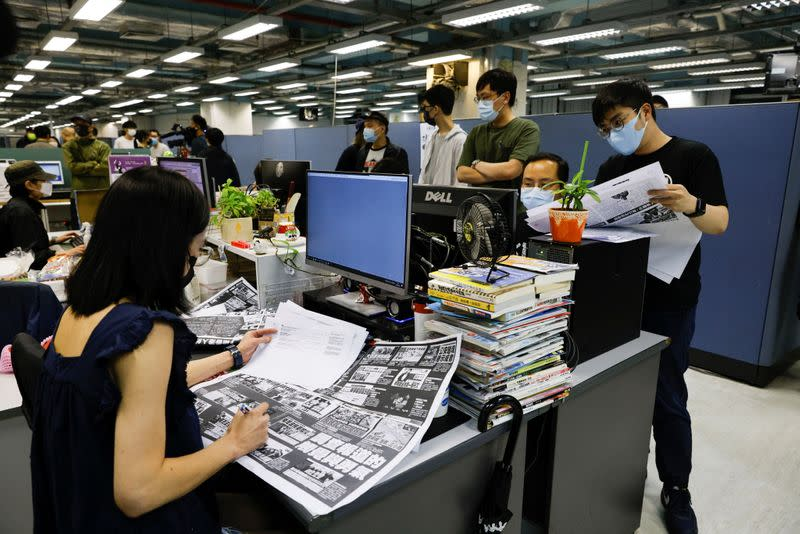 Staff members of Apple Daily work on their final edition in Hong Kong
