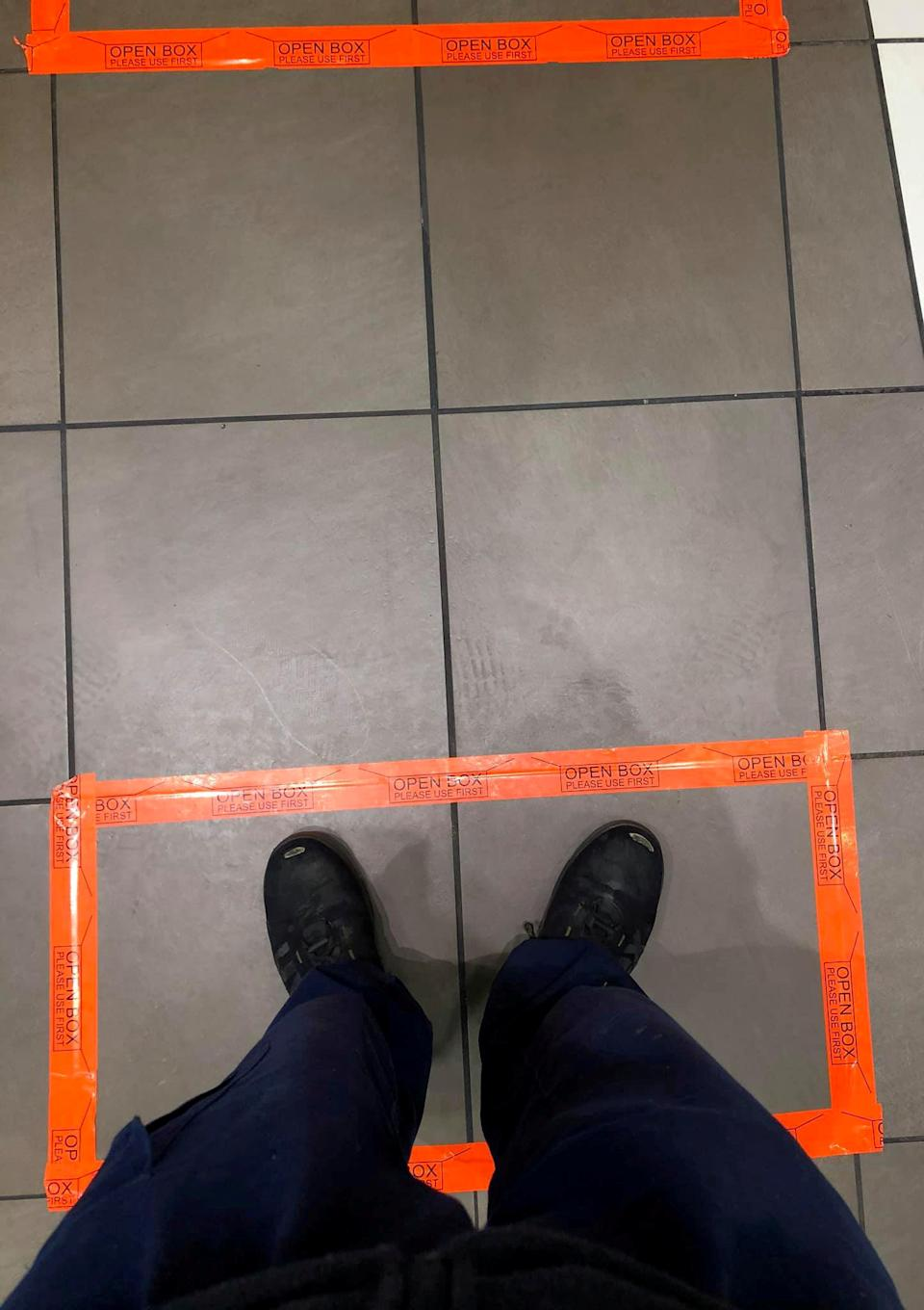 Customer have to stand in these boxes (Picture: SWNS)