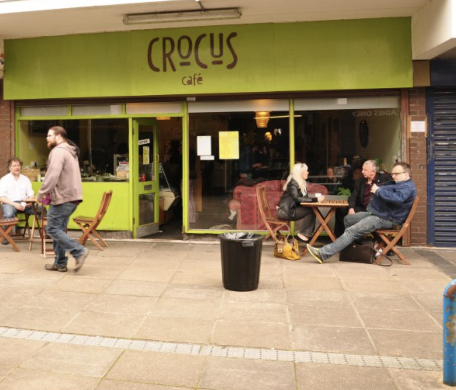 Photo shows the front of Crocus Cafe after it was targeted by students.