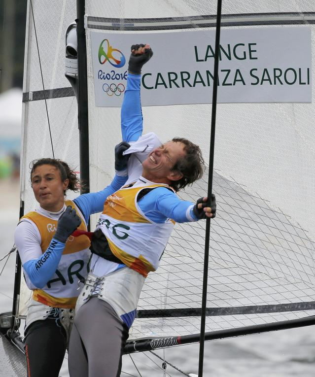 2016 Rio Olympics - Sailing - Final - Mixed Multihull - Nacra 17 - Medal Race - Marina de Gloria - Rio de Janeiro, Brazil - 16/08/2016. Santiago Lange (ARG) of Argentina and Cecilia Carranza (ARG) of Argentina celebrate winning gold medal. REUTERS/Brian Snyder FOR EDITORIAL USE ONLY. NOT FOR SALE FOR MARKETING OR ADVERTISING CAMPAIGNS.