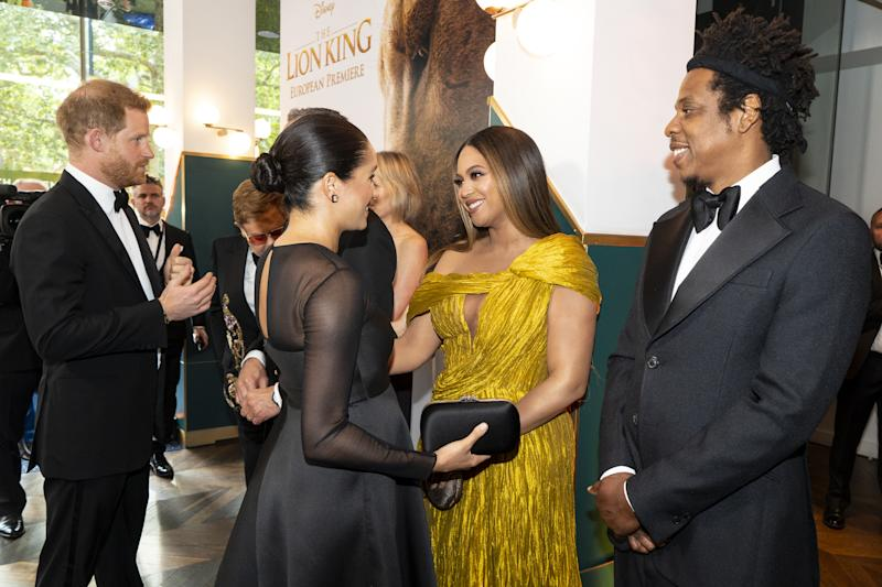 "LONDON, ENGLAND - JULY 14: Prince Harry, Duke of Sussex (L) and Meghan, Duchess of Sussex (2nd L) meets cast and crew, including Beyonce Knowles-Carter (C) Jay-Z (R) as they attend the European Premiere of Disney's ""The Lion King"" at Odeon Luxe Leicester Square on July 14, 2019 in London, England. (Photo by Niklas Halle'n-WPA Pool/Getty Images)"