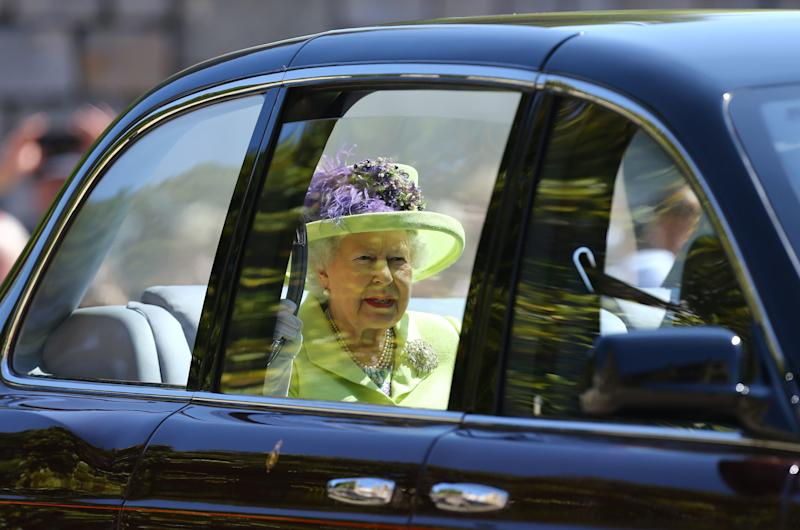 Queen Elizabeth II arrives at St George's Chapel at Windsor Castle before the wedding of Prince Harry to Meghan Markle on May 19, 2018 in Windsor, England.