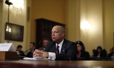 U.S. Department of Homeland Security Secretary Johnson listens to a question from a Republican member of Congress as he defends Obama's executive action on immigration at Capitol Hill in Washington
