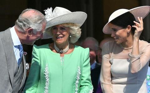 The Prince of Wales, Duchess of Cornwall and Duchess of Sussex at a garden party - Credit: Pool