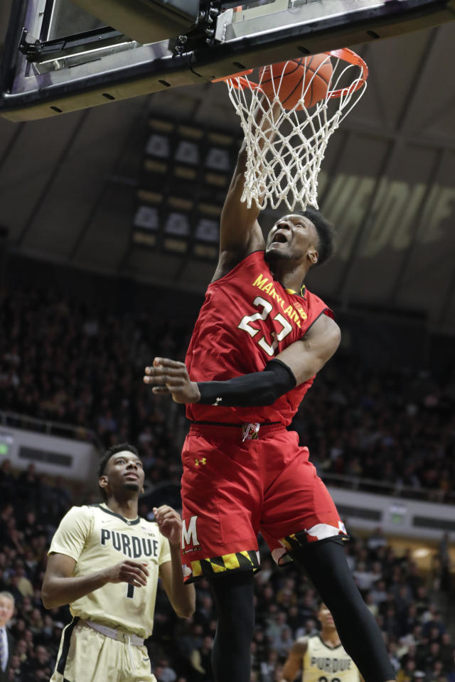 Maryland forward Bruno Fernando (23) dunks in front of Purdue forward Aaron Wheeler (1) during the first half of an NCAA college basketball game in West Lafayette, Ind., Thursday, Dec. 6, 2018. (AP Photo/Michael Conroy)