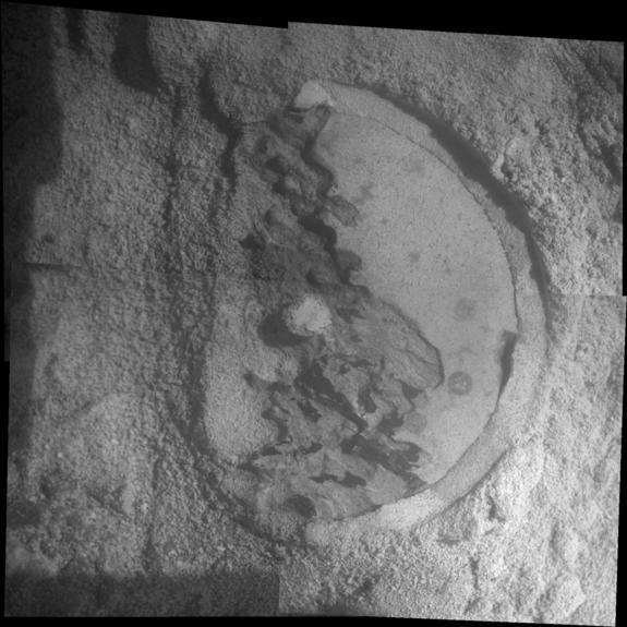"""This mosaic of four frames shot by the microscopic imager on the robotic arm of NASA's Mars Exploration Rover Opportunity shows a rock target called """"Esperance"""" after some of the rock's surface had been removed by Opportunity's rock abrasion to"""