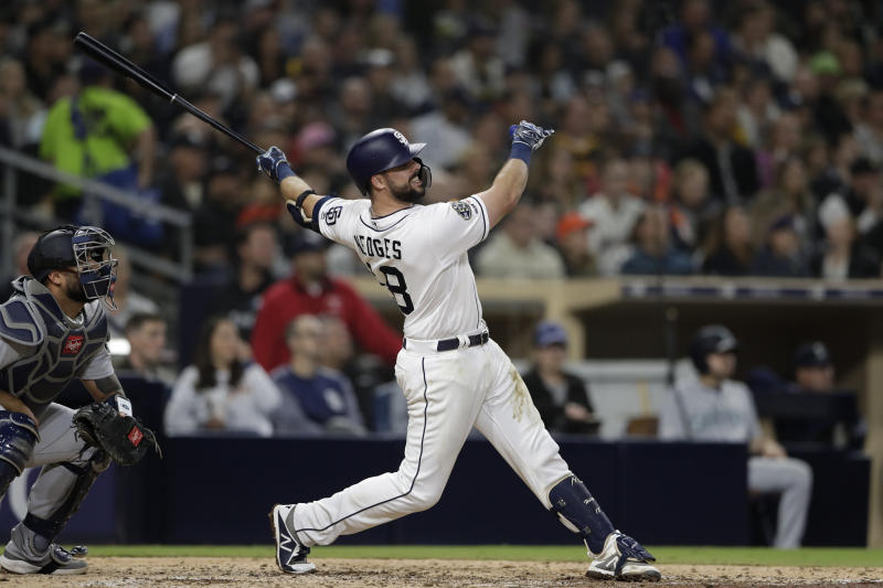 San Diego Padres' Austin Hedges watches his two-run home run hit during the sixth inning of a baseball game against the Seattle Mariners, Tuesday, April 23, 2019, in San Diego. (AP Photo/Gregory Bull)