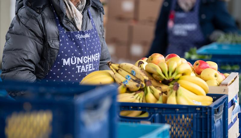 22 November 2019, Bavaria, Munich: Volunteers of the Münchner Tafel sort food for the guests at the issuing point at the wholesale market. At the approximately 170 tables in Bavaria, about 7000 mostly volunteer helpers distribute donated food to needy people. Photo: Sven Hoppe/dpa (Photo by Sven Hoppe/picture alliance via Getty Images)