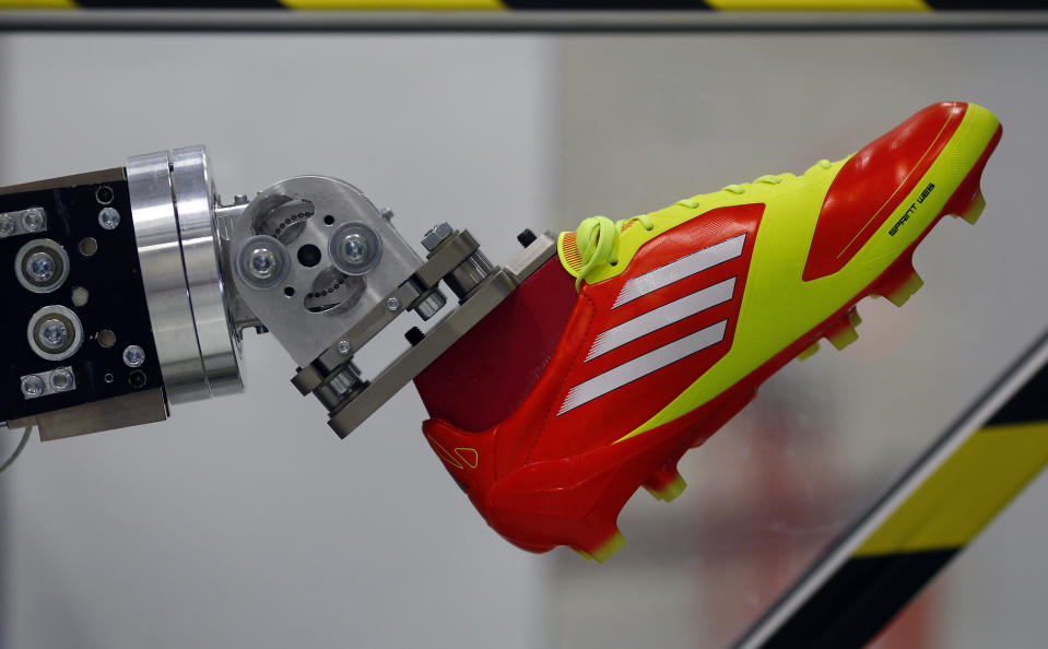 A robotic leg is pictured at the Adidas innovation laboratory in Herzogenaurach May 7, 2012. U.S. market leader Nike and German rival Adidas are locked in their own Olympic battle to boost athletes' performance and squeeze maximum value out of the London Olympic Games. The Games provide a showcase for new fashions and advances in technology which sportswear suppliers hope will drive sales at a time of economic turmoil in many of their markets, according to news reports on June 20, 2012. Picture taken on May 7, 2012. To match story OLY-BRANDS-BATTLE/   REUTERS/Michael Dalder (GERMANY - Tags: BUSINESS SCIENCE TECHNOLOGY SPORT OLYMPICS)