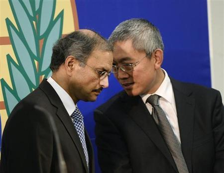 Ellahi, political adviser to OPCW Director General Uzumcu, talks to Wang, OPCW's external relations director, during a news conference in The Hague