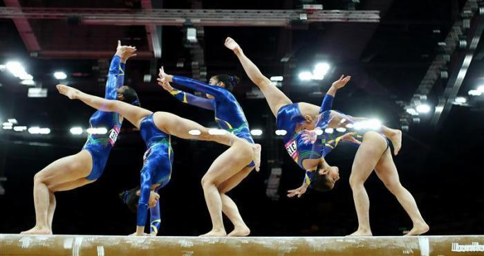 Bruna Kuroiwa Yamamoto Leal of Brazil competes in the balance beam during the women's gymnastics qualification in the North Greenwich Arena during the London 2012 Olympic Games July 29, 2012.
