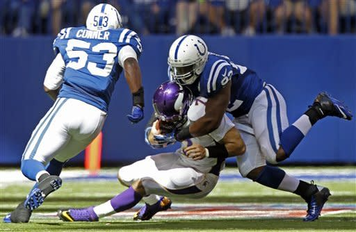 Minnesota Vikings' Christian Ponder is tackled by Indianapolis Colts' Jerry Hughes (92) and Kavell Conner during the second half of an NFL football game in Indianapolis, Sunday, Sept. 16, 2012. (AP Photo/Michael Conroy)